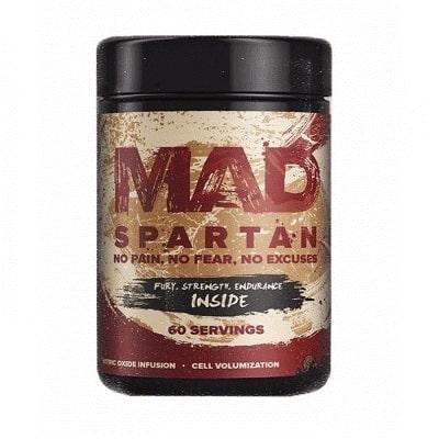 Mad drugs Mad Spartan – очень мощный предтренировочный комплекс, который включает в себя эфедру, герань, синефрин, ноопепт и ряд других хардкорных компонентов. При этом содержит в себе высокие дозировки, и гарантирует действительно суровую энергию, заряд бодрости, силу, выносливость, повышение внимания, концентрации, улучшение настроения.  Данный бренд специализируется на крутых составах и самое главное очень трудно доставаемых компонентах, которые многие бренды просто не могут себе позволить. Эксклюзивностью данной добавки является ноопепт, герань и эфедра, все три компонента оказывают максимально положительный эффект для ваших тренировок.  Положительные эффекты Mad Spartan от Mad drugs: -Максимальная умственная и физическая энергия -Повышение психоэмоционального подъёма -Снижается болевой порог, возникающий после тренировок -Повышает выносливость, позволяет продлить тренировки -Ускоряется набор мышечной массы и силы -Увеличение рабочих показателей во всех упражнениях  Другие компоненты, входящие в состав комплекса: -Герань – целых 100 мг на каждую порцию самого крутого стимулятора ЦНС, который повышает концентрацию, улучшает настроение, и заставляет проводить ваши тренировки на пределе возможного -Синефрин – аналог эфедры, позволяет избавить от жира за счет ускорения обмена веществ, улучшает настроение, придает энергии. -Эфедра – обладает жиросжигающими свойствами, ускоряет обмен веществ, улучшает производительность. -Бета-аланин – снижает мышечную усталость, позволяет тренироваться дольше и эффективнее. -Трибулус— растительный компонент, позволяющий повышать уровень естественного тестостерона. -Аргинин – улучшает мышечную наполненность, создает эффект пампинга. Тем самым ускоряется процесс восстановления мышц.